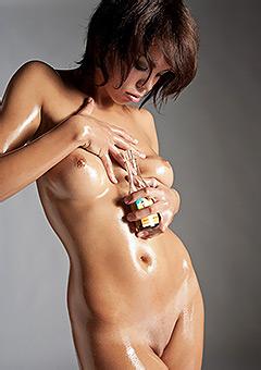 Erotic Brunette Gets Oiled