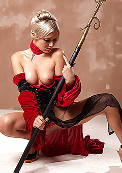 Sexy Warrior In A Red Outfit Posing