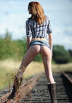 Elena Posing On The Rails